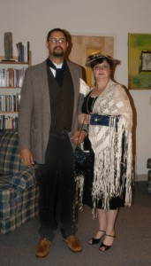 Murder Mystery participants in costume in character and appearing very high class.